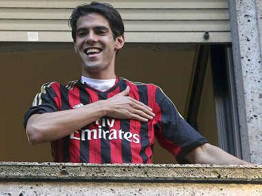 Brazilian player Kaka gestures as he wears an AC Milan jersey. Reuters