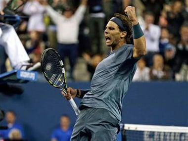 Nadal celebrates after scoring a point against Djokovic: AP