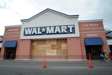 Wal-Mart pays lawyer fees for more than 30 execs in bribery probe