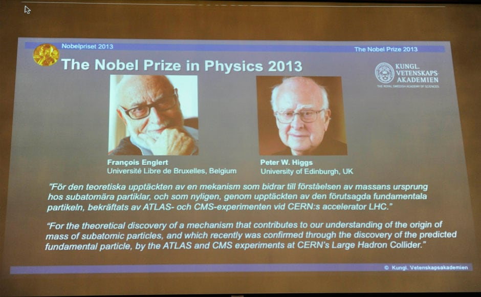 A picture Francois Englert of Belgium and Britain's Peter Higgs, laureates of the 2013 Nobel Prize in Physics, are displayed on a screen during a news conference at the Royal Swedish Academy of Sciences in Stockholm 8 October, 2013. Higgs and Englert won the Nobel Prize for physics on Tuesday for predicting the existence of the Higgs boson particle that explains how elementary matter attained the mass to form stars and planets. Erik Martensson/TT News Agency/Reuters