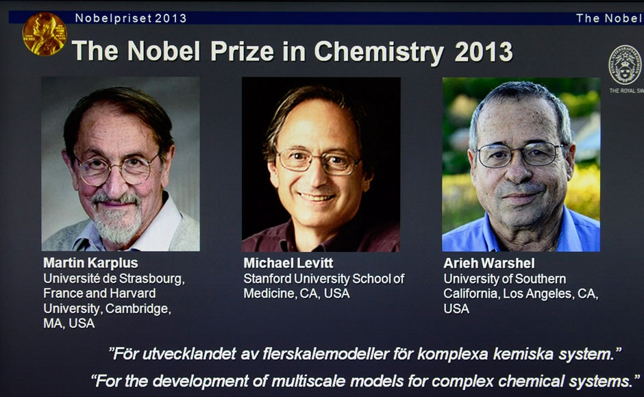 Photos of Martin Karplus, Michael Levitt and Arieh Warshel, the three laureates of the 2013 Nobel Prize for Chemistry, is seen on a screen during the announcement of the winners at the Royal Swedish Academy of Sciences in Stockholm October 9, 2013. Karplus, Levitt and Warshel won the 2013 Nobel Prize for chemistry for the development of multiscale models for complex chemical systems, the award-giving body said on Wednesday. REUTERS/Claudio Bresciani/TT News Agency