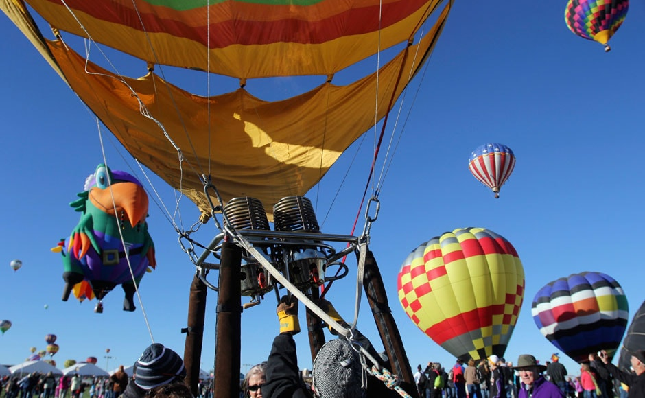 A pilot sits in the basket of a hot air balloon before it takes flight: Reuters