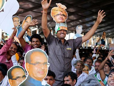 BJP workers wearing Shivraj Singh Chouhan face masks at a rally. AFP