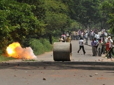 An Indian police tear gas canister exlpodes near students as they throw stones towards police at Osamnia University Campus during a protest demanding the separate state of Telangana in Hyderabad on September 19, 2011. The Telangana Joint Action Committee (T-JAC), which called the general strike involving all sections demanding a separate state, entered the seventh day which has brought the administration to a grinding halt in Telangana districts and several administrations in the state capital of Hyderabad. AFP