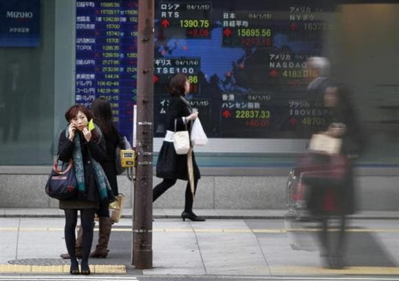 Asian shares edge up, PBOC cash injection calms China markets