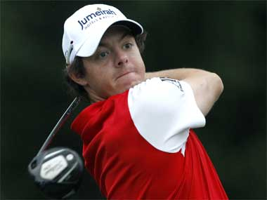 McIlroy sizzles in Dubai; Woods among chasing pack