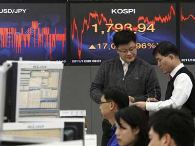 Asian stocks hit seven-year high on eurozone hopes