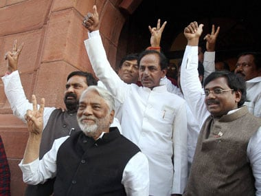 TRS chief K Chandrasekhar Rao flashes the victory sign with party leaders after the  passage of Telangana bill by the Lok Sabha. PTI