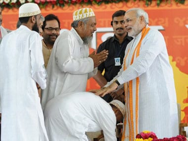 Modi with his Muslim supporters. AFP.