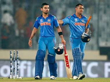 India's captain Mahendra Singh Dhoni and teammate Virat Kohli celebrate their win over Bangladesh in the ICC Twenty20 Cricket World Cup match in Dhaka. AP
