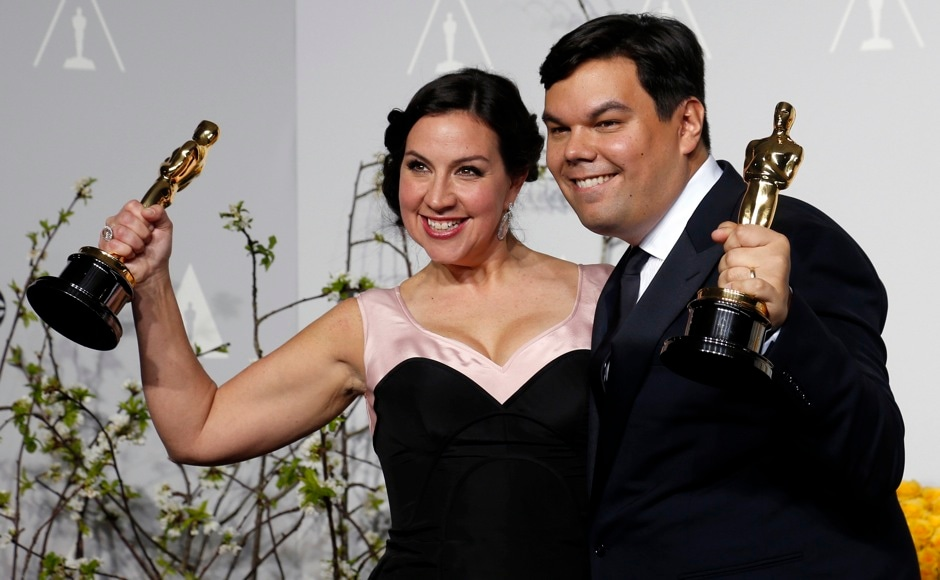 "Kristen Anderson-Lopez and Robert Lopez hold their Oscars for Best Original Song for ""Let it Go"" in the film ""Frozen"" at the 86th Academy Awards in Hollywood, California March 2, 2014  REUTERS"