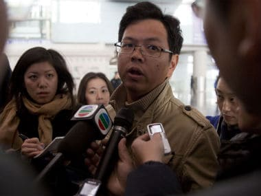A person who has a relative on the flight speaks to the media in Kuala Lumpur. AP