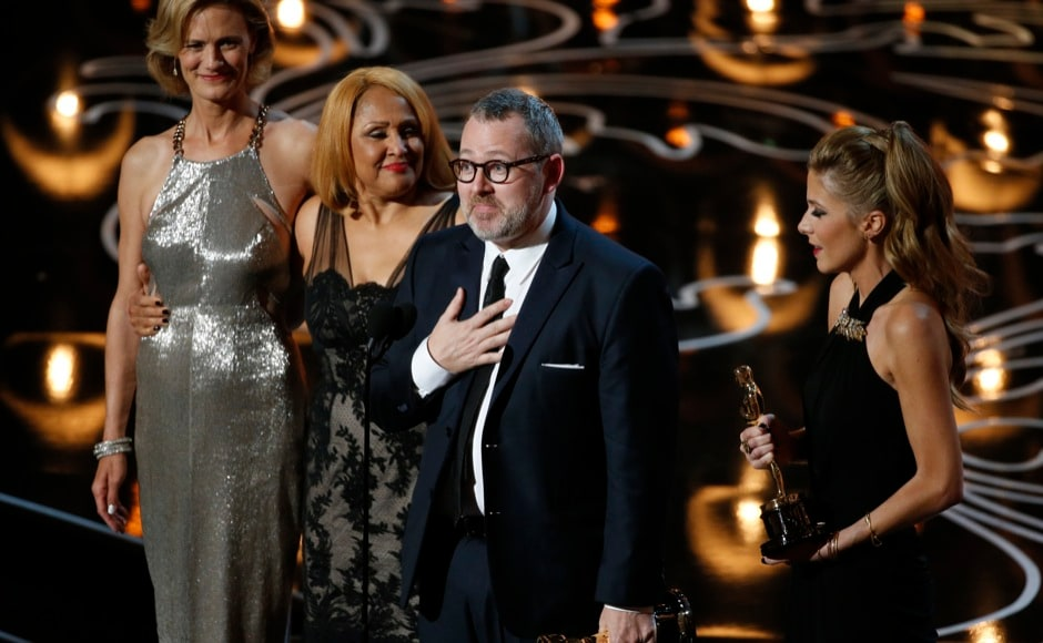 "Morgan Neville, Gil Friesen (not present), Caitrin Rogers (R) and Darlene Love (2nd from L) are presented the Oscar for best documentary feature for ""20 Feet from Stardom"" at the 86th Academy Awards in Hollywood, California March 2, 2014.   REUTERS"