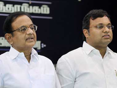 Chidambaram along with son Karti. PTI