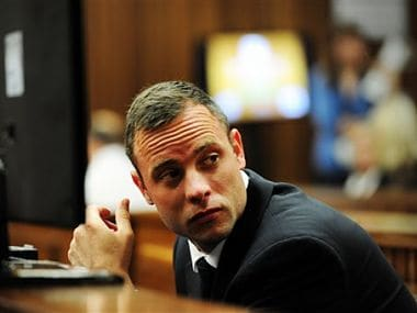 Oscar Pistorius glances sideways as he listens to ballistic evidence being given in court in Pretoria, South Africa on March 19. AP