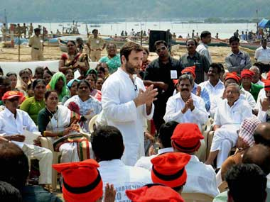 Rahul Gandhi interacting with Kolis in Mumbai. PTI