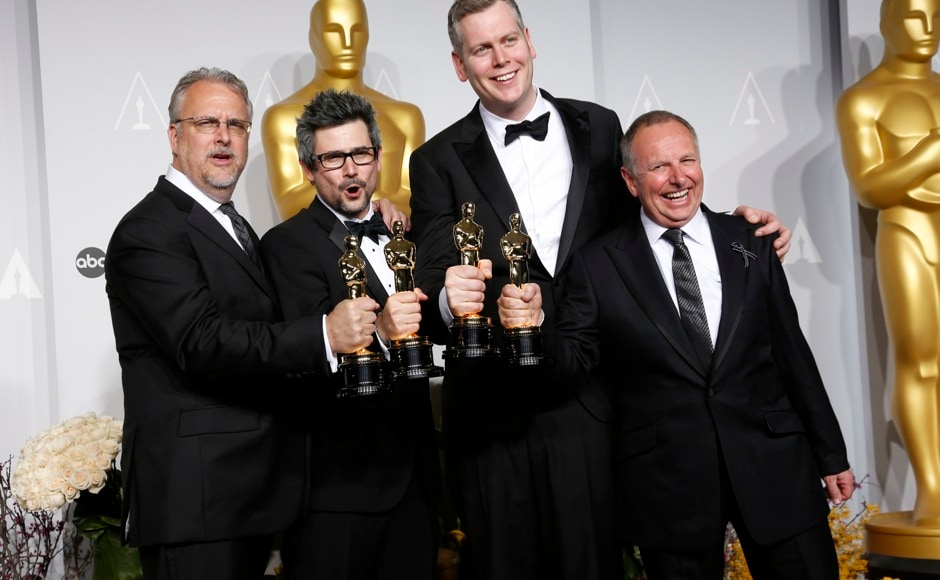 "Skip Lievsay, Niv Adiri, Christopher Benstead and Chris Munro (L-R) hold their Oscars for Sound Mixing for the film ""Gravity"" at the 86th Academy Awards in Hollywood, California March 2, 2014.  REUTERS"