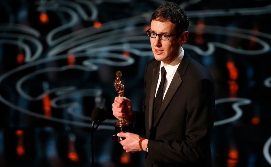 "Steven Price accepts the Oscar for original score for ""Gravity"" at the 86th Academy Awards in Hollywood, California March 2, 2014.   REUTERS"