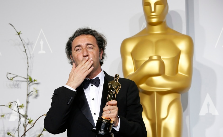 "Paolo Sorrentino, director of Italian film ""The Great Beauty,"" poses with his award for best foreign language film at the 86th Academy Awards in Hollywood, California March 2, 2014.  REUTERS"