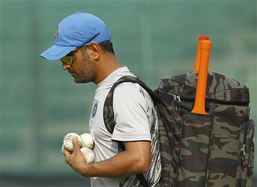 India's captain Mahendra Singh Dhoni walks to the nets during a training session ahead of their ICC Twenty20 Cricket World Cup semifinal. AP