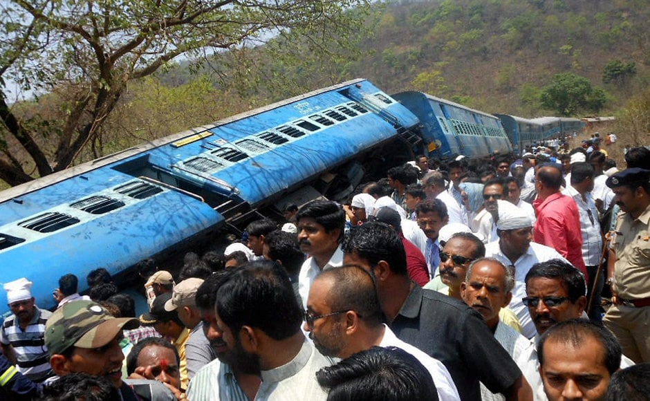 People gather near the passenger train accident site which derailed at Nagothane in Raighad district, Maharashtra on Sunday. PTI