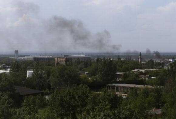 "Battle at Donetsk airport; new Ukraine leader says no talks with ""terrorists"""