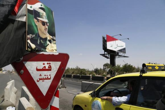 Street by street, Assad extends grip in central Syria