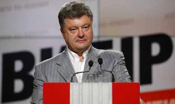 Man in a hurry, Ukraine's new leader flashes steel behind smile