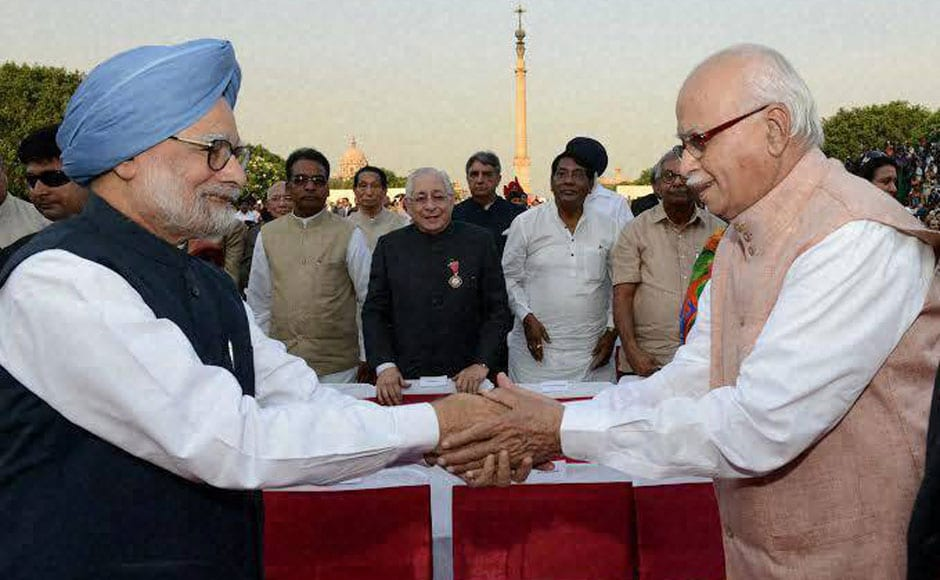 They may have hurled accusations at each other during the poll campaigns, but during the swearing in former PM Manmohan Singh and BJP leader LK Advani were ever so courteous to each other. PTI