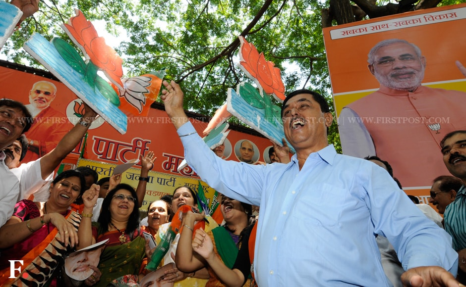 The BJP is all set to form a Modi-led government. Party workers waved the lotus symbol in celebration. Mexy Xavier/Firstpost