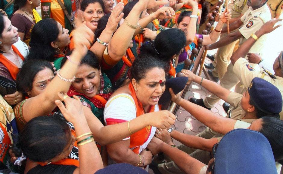 Bharatiya Janata Party activists under demonstrate against the metro train fare hike at Bandra in Mumbai on Wednesday. PTI