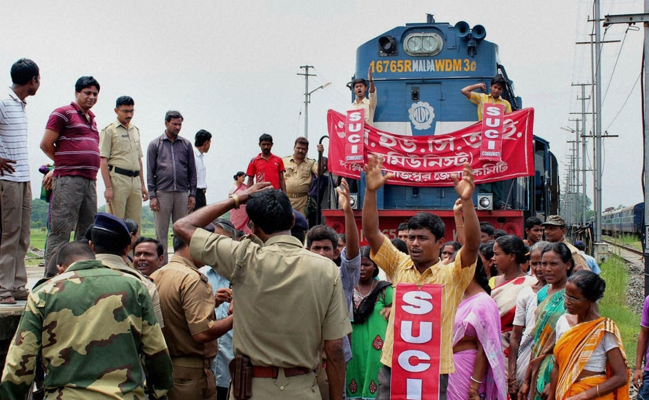 SUCI activists stop the Balurghat-New Jalpaiguri Intercity Express train to protest against the hike rail fare hike at Balurghat Railway station in South Dinajpur district of West Bengal, on Wednesday. PTI
