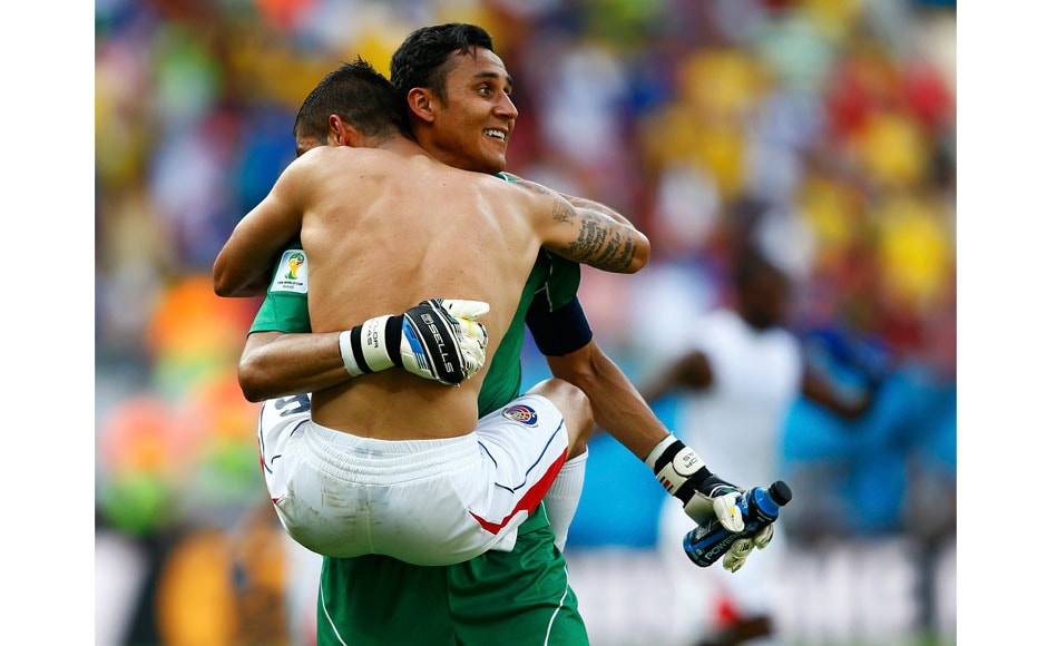 The final whistle went off and the Costa Rica players and fans went berserk. Here's Costa Rica's goalkeeper Keilor Navas (back) and teammate Oscar Duarte celebrating after the win. Reuters