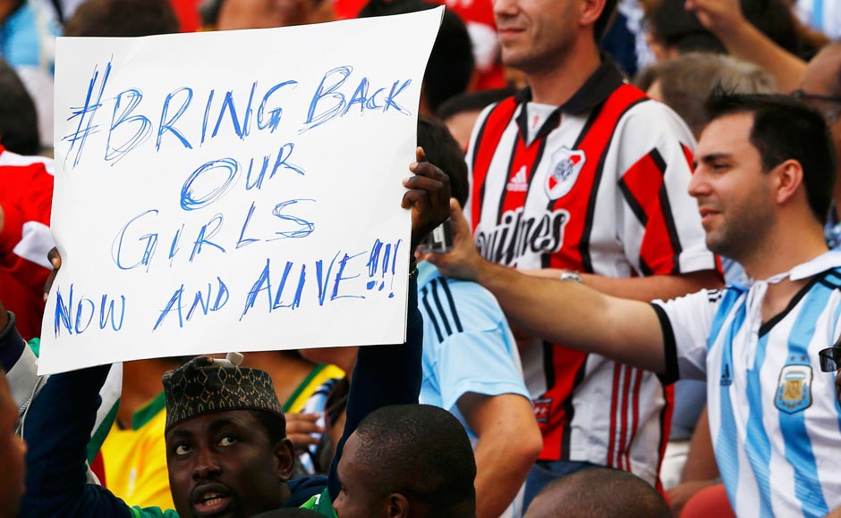 A fan of Nigeria holds up a sign referring to the Boko Haram kidnapping during their 2014 World Cup Group F soccer match against Argentina at the Beira Rio stadium in Porto Alegre June 25, 2014.   REUTERS