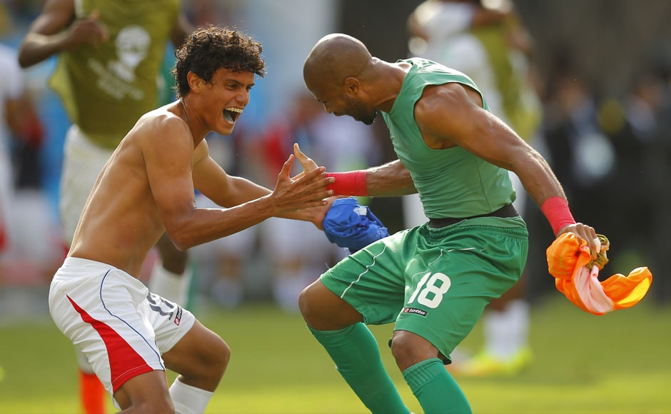 Costa Rica's Yeltsin Tejeda (L) and Patrick Pemberton celebrate in a special way after the win. Reuters