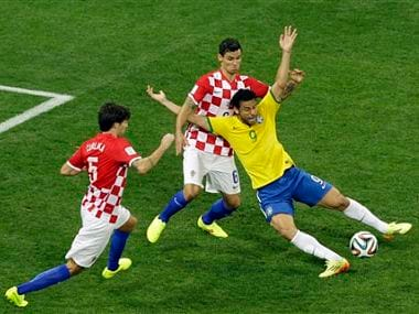 Brazils Fred says it was a clear penalty on him