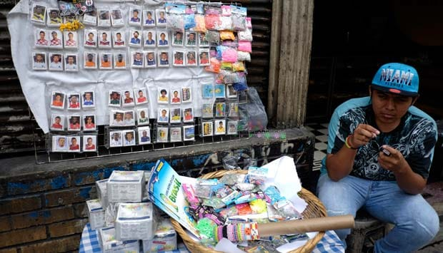 A man sells stickers for the official 2014 FIFA World Cup sticker album in a downtown street in Guatemala City, June 8, 2014. Italian publishing company Panini has issued the sticker album for every World Cup since the 1970 tournament in Mexico: Reuters
