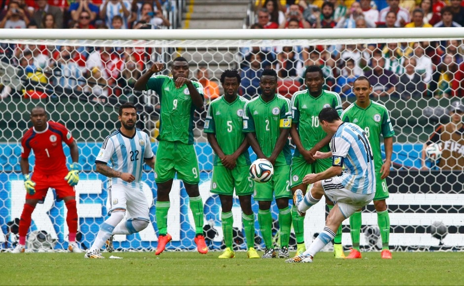 Argentina's Lionel Messi scores on a free kick during the 2014 World Cup Group F soccer match against Nigeria at the Beira Rio stadium in Porto Alegre June 25, 2014.  REUTERS