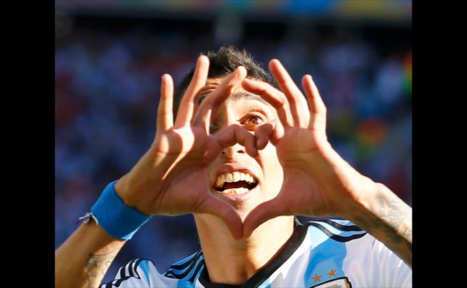 Argentina's Angel Di Maria celebrates scoring against Switzerland during extra time in their 2014 World Cup round of 16 game at the Corinthians arena in Sao Paulo July 1, 2014.  REUTERS
