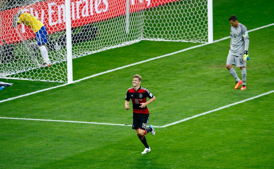 Germany's Toni Kroos celebrates scoring his team's fourth goal against Brazil during their 2014 World Cup semi-finals at the Mineirao stadium in Belo Horizonte July 8, 2014. REUTERS