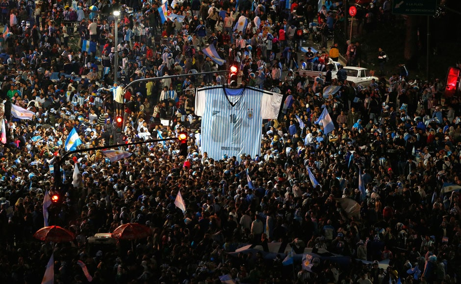 Argentina's fans gather around a giant cut-out of Lionel Messi's jersey, after Argentina lost to Germany in their 2014 World Cup final soccer match in Brazil, at a public square viewing area in Buenos Aires, July 13, 2014. REUTERS