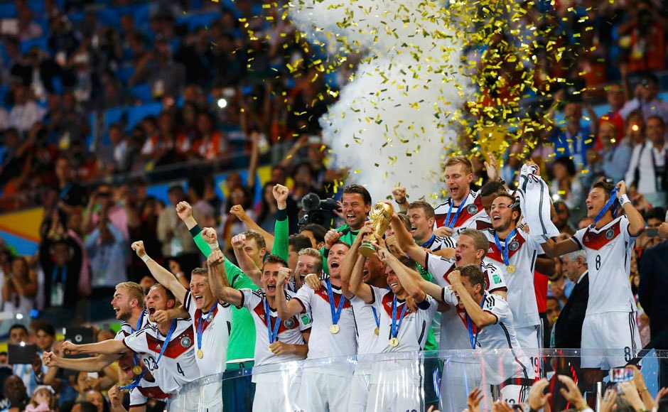 Germany's players lift the World Cup trophy as they celebrate their 2014 World Cup final win against Argentina at the Maracana stadium in Rio de Janeiro July 13, 2014. REUTERS