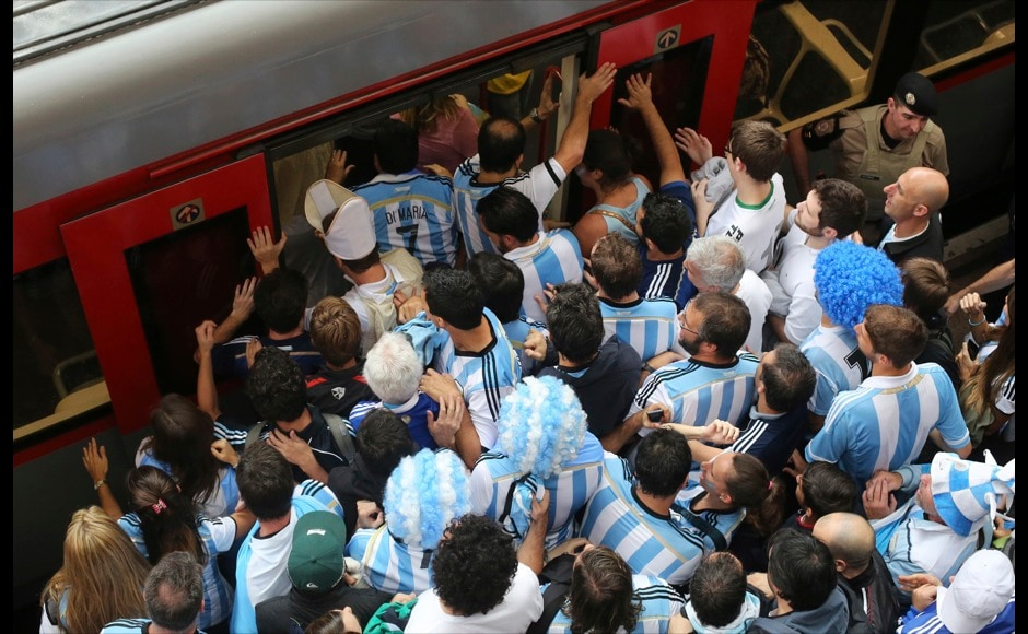 Argentina fans board a train at Luz Station to catch the 2014 World Cup semi-final soccer match between Argentina and Netherlands at Corinthians arena in Sao Paulo July 9, 2014.   REUTERS