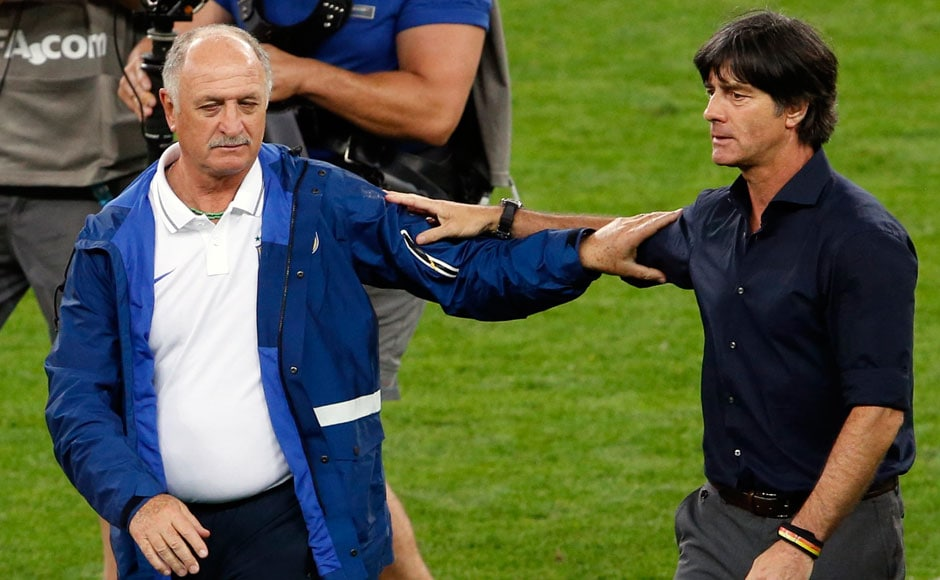 Brazil's coach Luiz Felipe Scolari (L) congratulates Germany's coach Joachim Loew after Germany won their 2014 World Cup semi-finals at the Mineirao stadium in Belo Horizonte July 8, 2014. REUTERS