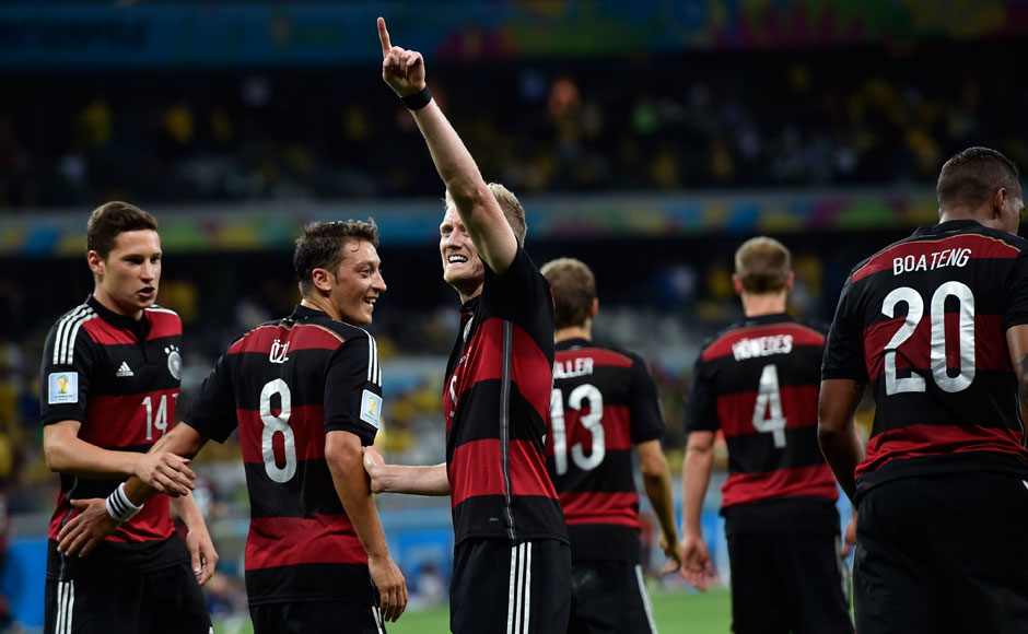 Germany's Andre Schuerrle celebrates after scoring his side's seventh goal during the World Cup semifinal soccer match between Brazil and Germany at the Mineirao Stadium in Belo Horizonte, Brazil, Tuesday, July 8, 2014. AP