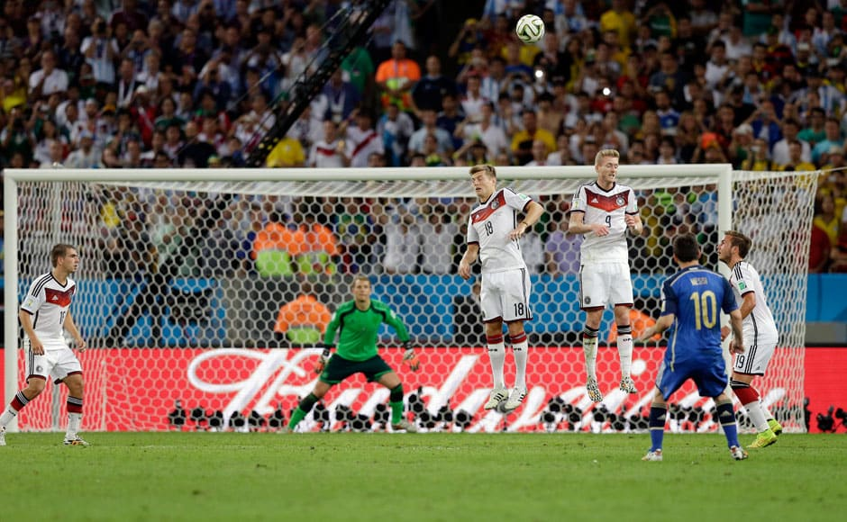 Argentina's Lionel Messi, second right, shoots a free kick over the Germany goal in the extra-time of the World Cup final soccer match between Germany and Argentina at the Maracana Stadium in Rio de Janeiro, Brazil, Sunday, July 13, 2014. Germany beat Argentina 1-0 to win its fourth World Cup title.  AP