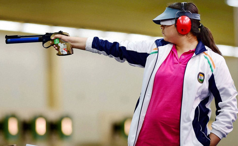 India's silver medalist shooter Malaika Goel aims at the target in final round of women's 10M Air Pistol event at the Commonwealth Games in Glasgow. PTI