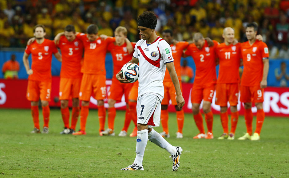 Costa Rica's Christian Bolanos (front) walks up to take his penalty shot. Bolanos made it 3-3 as he smashed one to the top left corner, Krul went the right way but didn't manage to save it. Reuters