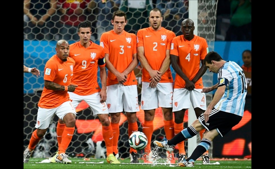 Argentina's Lionel Messi (R) takes a free kick near Netherlands' players (L-2nd R) Nigel de Jong, Robin van Persie, Stefan de Vrij, Ron Vlaar and Bruno Martins Indi during their 2014 World Cup semi-finals at the Corinthians arena in Sao Paulo July 9, 2014. REUTERS