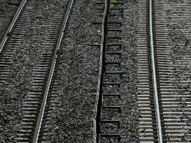 Woman falls onto railway track and dies, while two boys take pictures on their phones